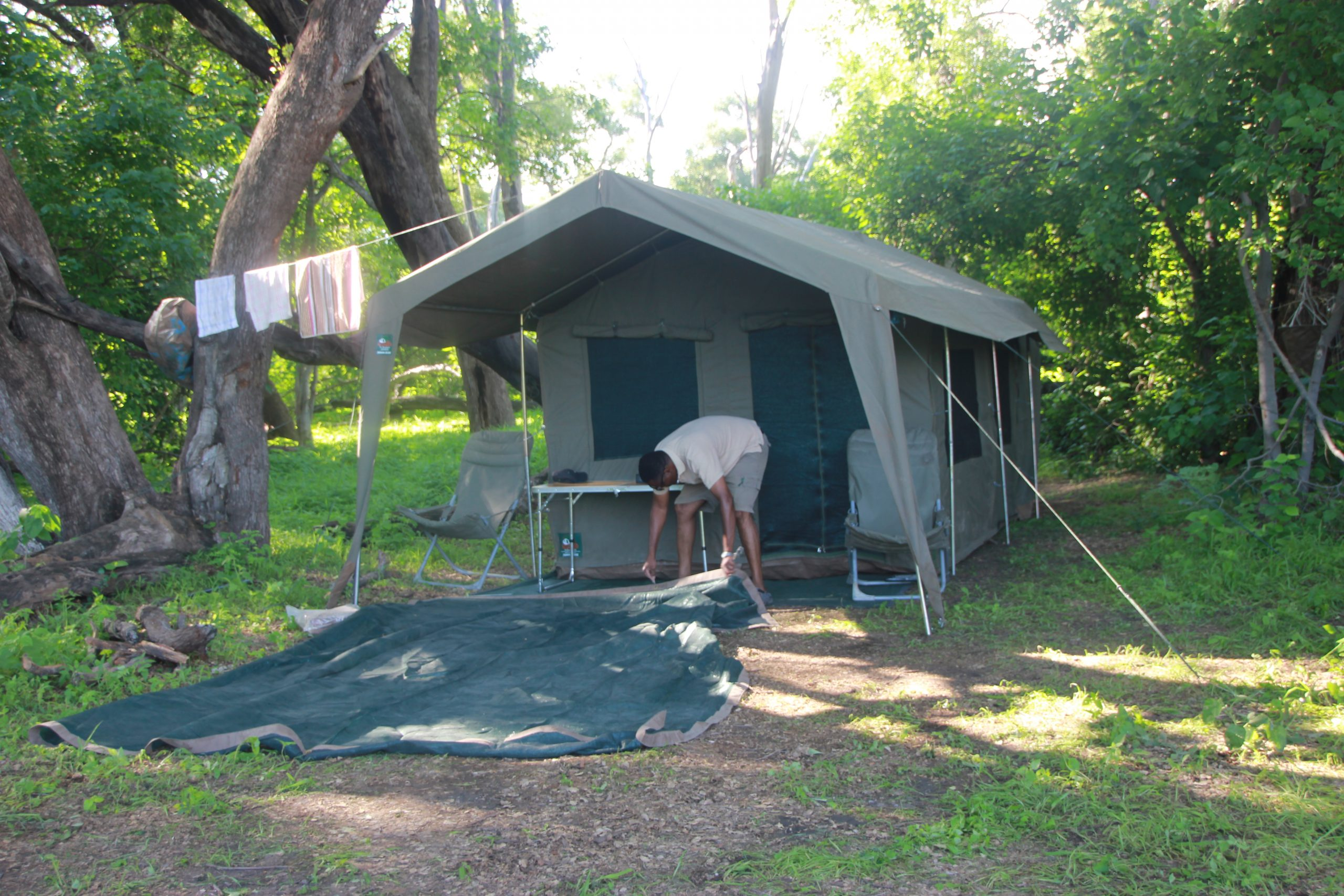 En-suite-Luxury tent being pitched for a very comfortable; home like camping, fitted with singe or double beds and other luxuries.